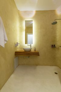Villa Sotavento VIP luxury villa retreat in Mykonos bathroom basin, mirror and shower.