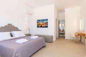 Villa Sotavento VIP luxury villa retreat in Mykonos bedroom with double bed, desk and A/C.