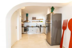 Large Kitchen with modern appliances of the Villa Kastro Windsurf & Kitesurf retreat in Mykonos.