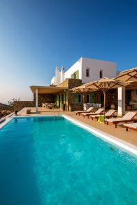 Villa Kastro luxury villa rental in Mykonos exterior, swimming pool and sun loungers.