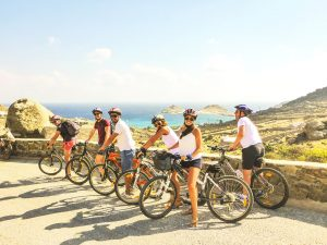 Team of cyclists on the island of Mykonos
