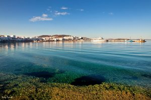Calm deep blue crystal clear sea waters in Mykonos. Blue sky with few clouds.